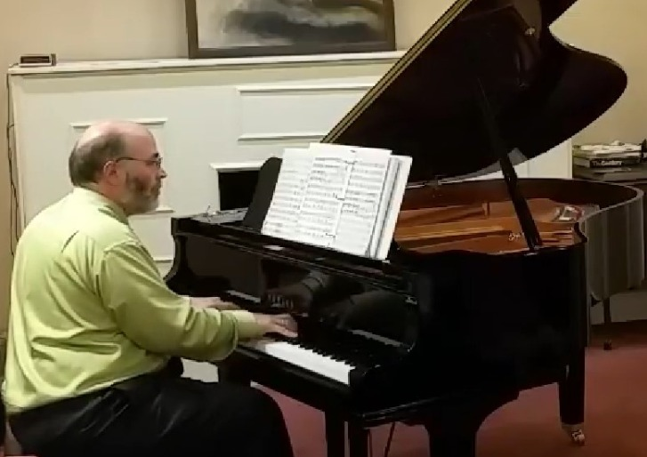Dr. Tkaczevski performing at the piano